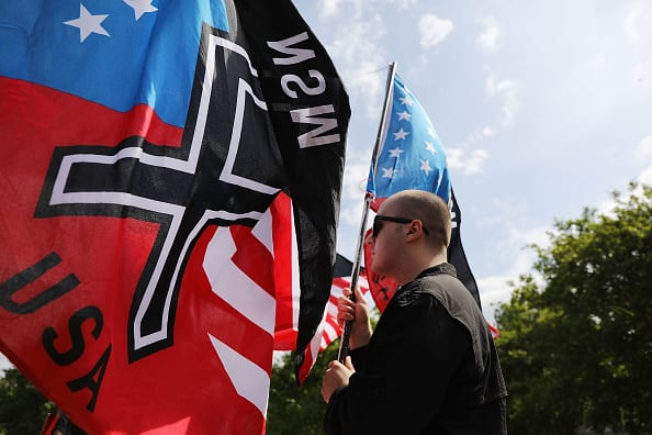 Members and supporters of the National Socialist Movement, one of the largest neo-Nazi groups in the US, hold a rally on April 21, 2018 in Newnan, Georgia. (Photo by Spencer Platt/Getty Images)