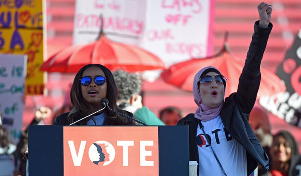 Women's March founder and Islamist activist Linda Sarsour (R) with Women's March co-founder Tamika Mallory at a voter registration event in Las Vegas in January 2018 (Photo: Ethan Miller/Getty Images)
