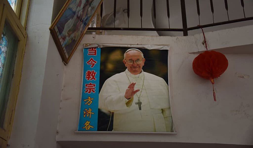 A poster of the Pope is seen in a closed church in Xincun, in China's central Henan province (Photo: GREG BAKER/AFP via Getty Images)