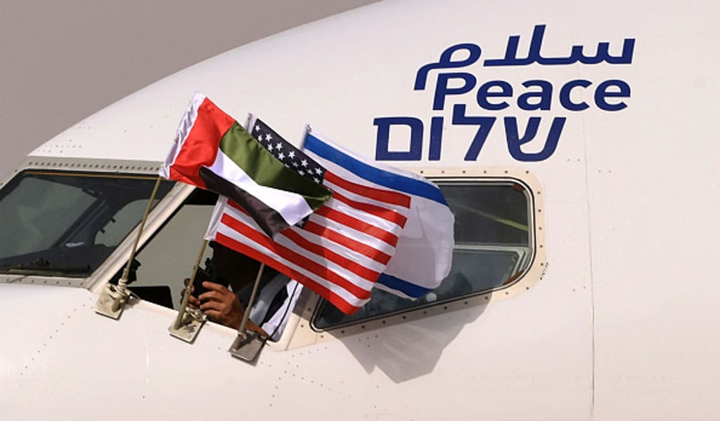 "The Emirati, Israeli and US flags attached to an Israeli El Al plane, on which was also written ""peace"" in Arabic, English and Hebrew, The flight on August 31, 2020 from Tel Aviv to Abu Dhabi was the first-ever commercial flight from Israel to the UAE (Photo: KARIM SAHIB/AFP via Getty Images)"