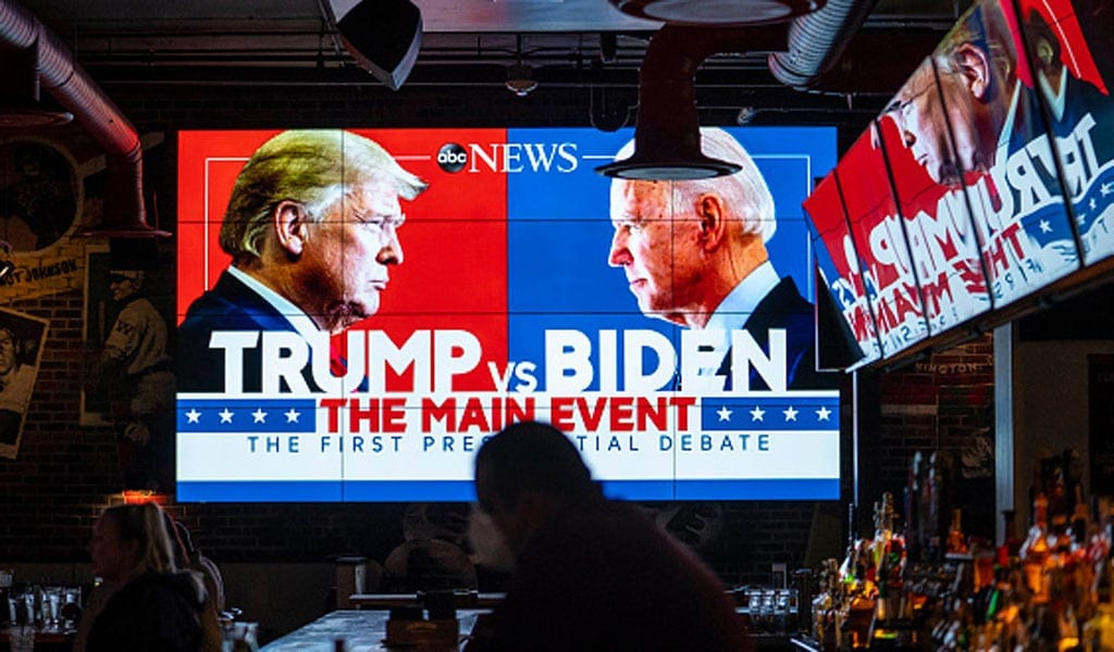 Television screens airing the first presidential debate at Walters Sports Bar in Washington, D.C. (Photo: Sarah Silbiger/Getty Images)