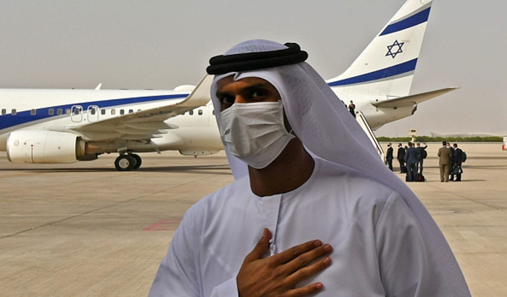 An Emirati official places his hand over his heart in front of the Israel El Al airliner, which arrived in the UAE on a historic flight with a delegation from Israel and the US. The plane was also allowed to fly over Saudi airspace (Photo: KARIM SAHIB/AFP via Getty Images)