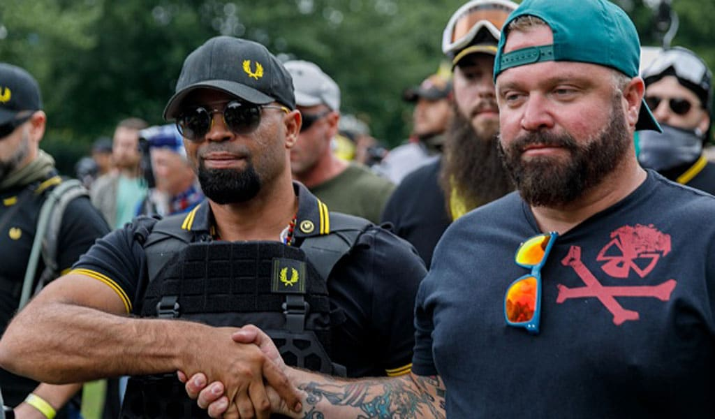 "Proud Boys leader Enrique Tarrio (L) with organizer Joe Biggs congratulate each other at the end of ""The End Domestic Terrorism"" rally in Portland August 17, 2019. No major incidents were reported despite a Far Left counter-demonstration at the event. (Photo: JOHN RUDOFF/AFP via Getty Images)"