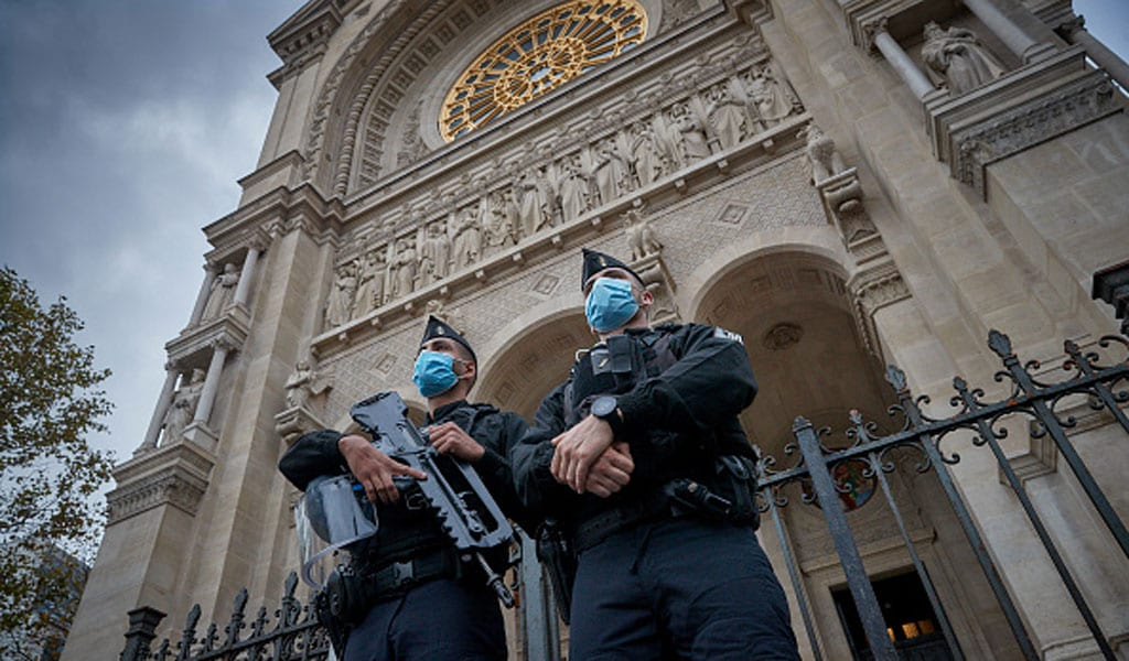 Armed guards stand outside the St. Augustine Church in Paris amidst escalating Islamist terror in France (Photo: Kiran Ridley/Getty Images)