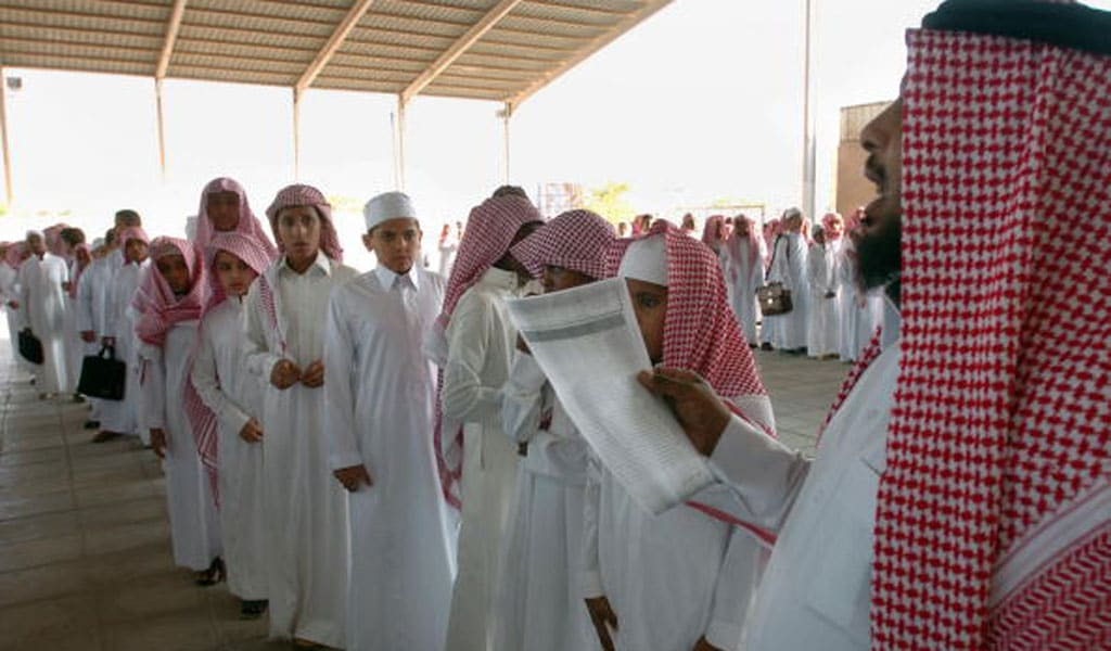 A teacher at a school in Saudi Arabia takes attendance on the first day of classes (Photo: STR/AFP via Getty Images)
