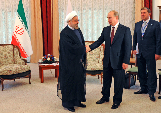 Man of influence? Russian President Vladimir Putin with his Iranian counterpart Hassan Rouhani